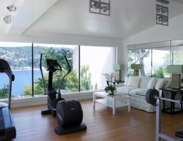 Home gym overlooking the sea by Thorpe Design