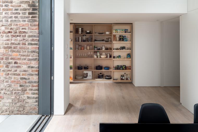 Storage walls conceal kitchen storage in the Passivhaus